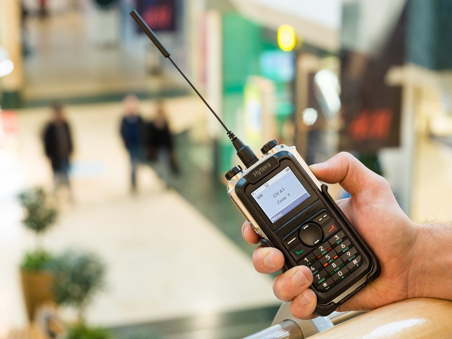 Hytera X1P advanced slimline DMR radio in use at shopping mall