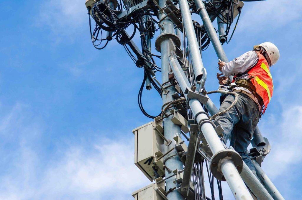 Radio engineer installing antenna system