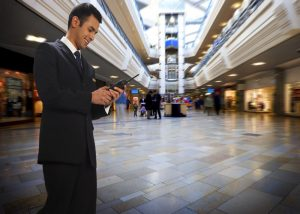 Hytera PD565 DMR walkie talkie in use at a shopping mall
