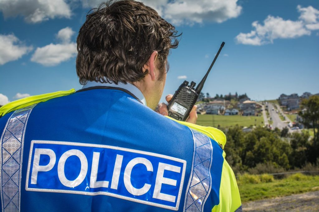 Tait TP9300 digital portable radio in use by a police officer